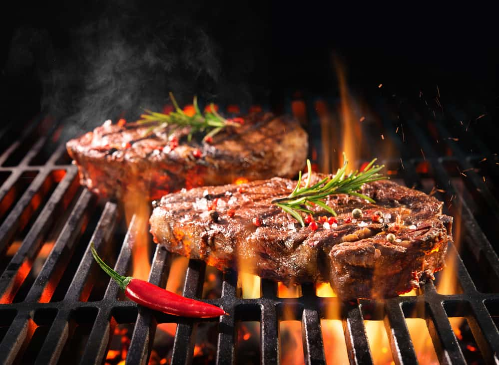 Grilled steaks with peppers on grill