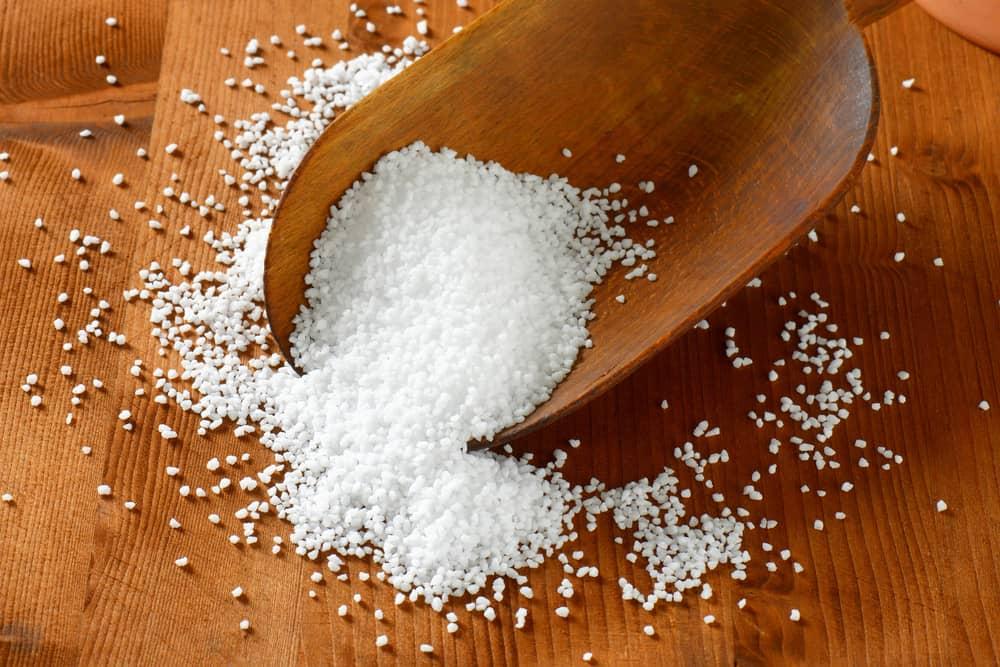 course salt on wooden spoon