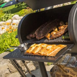 Offset smoker with fish and ribs