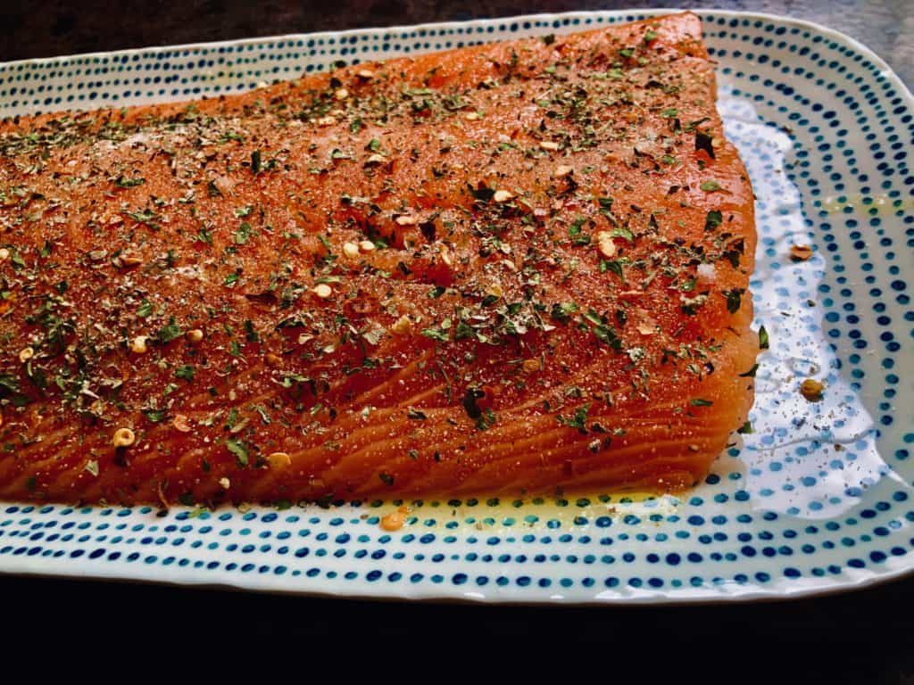 Salmon with oil and seasoned rub
