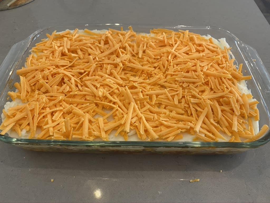 Pulled pork shepherd's pie grated cheese layer