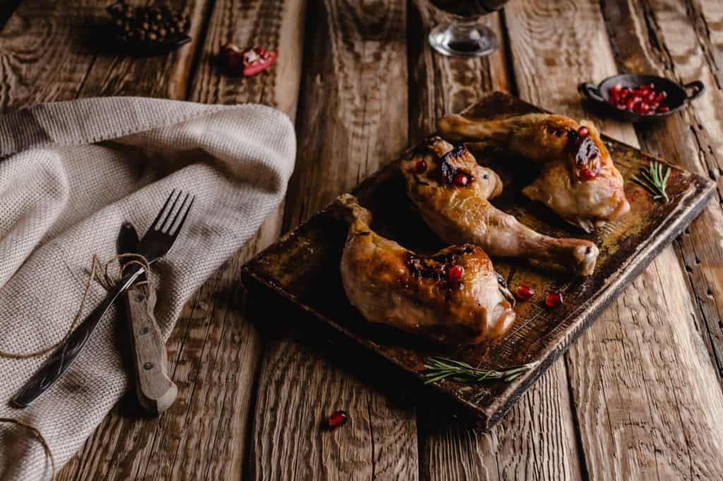 Chicken Legs on Wooden Board