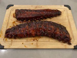 BBQ sauce added to ribs
