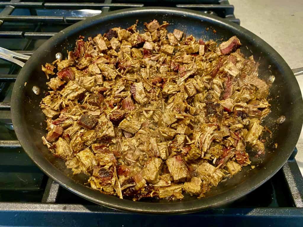 Brisket meat in frying pan