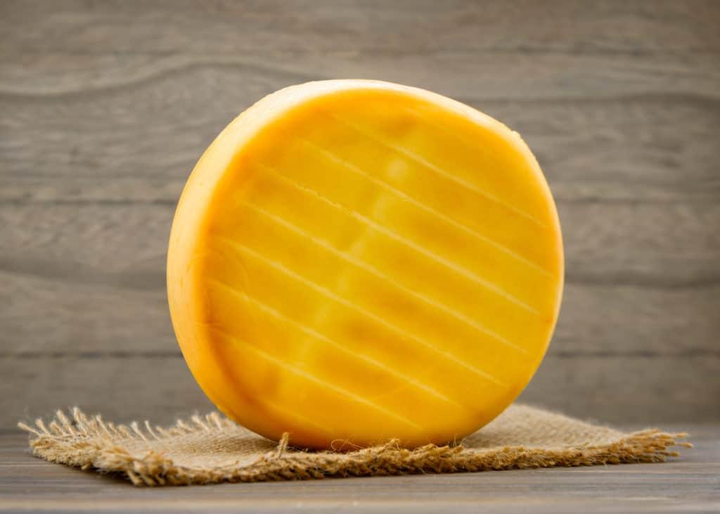 Smoked cheese wheel
