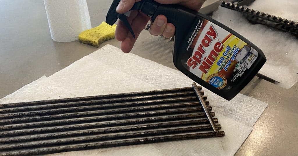 Using spray nine bbq cleaner on grates