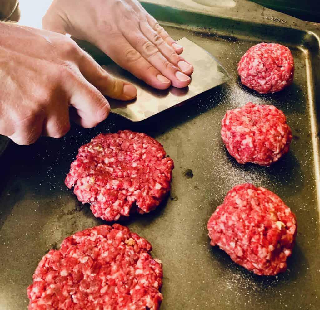 Preparing homemade smash burgers