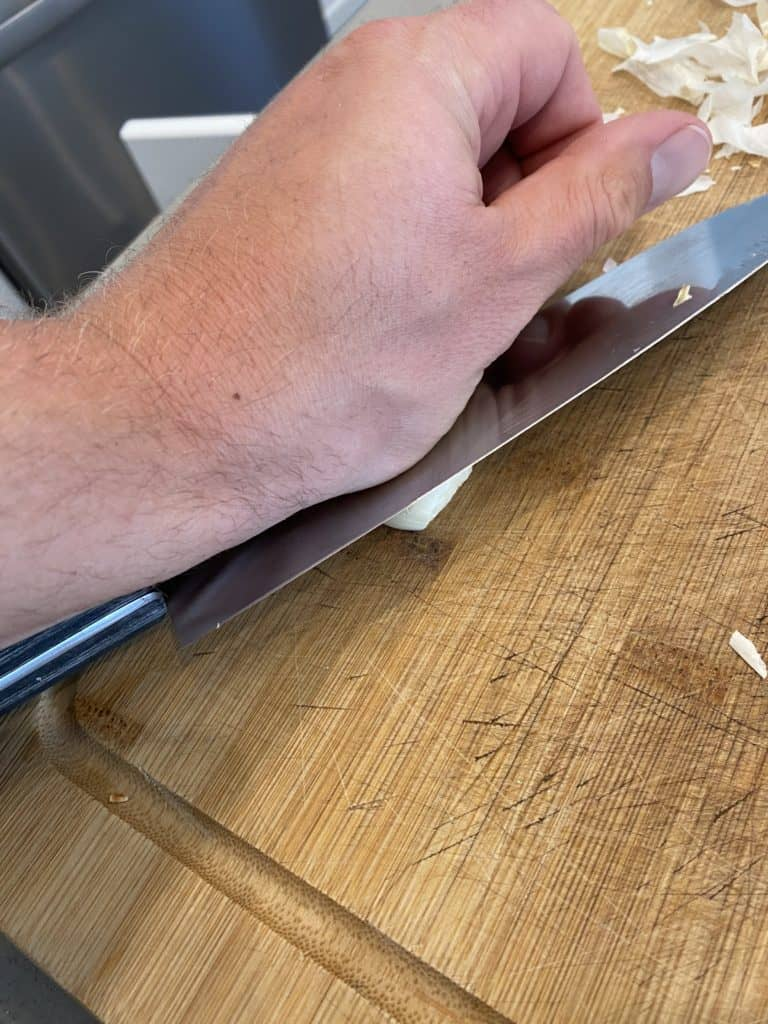 Crushing Garlic Cloves with Knife Side