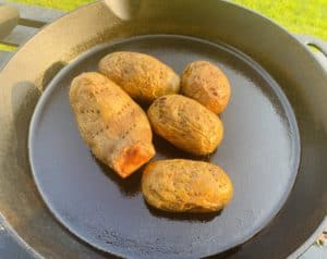 Grilled potatoes on cast iron pan